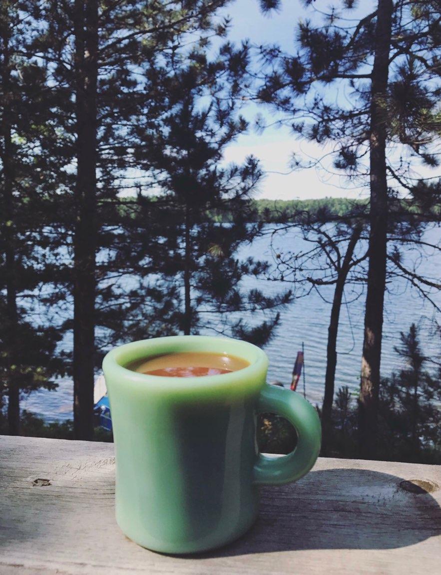 coffee mug on backporch overlooking northern wisconsin lake