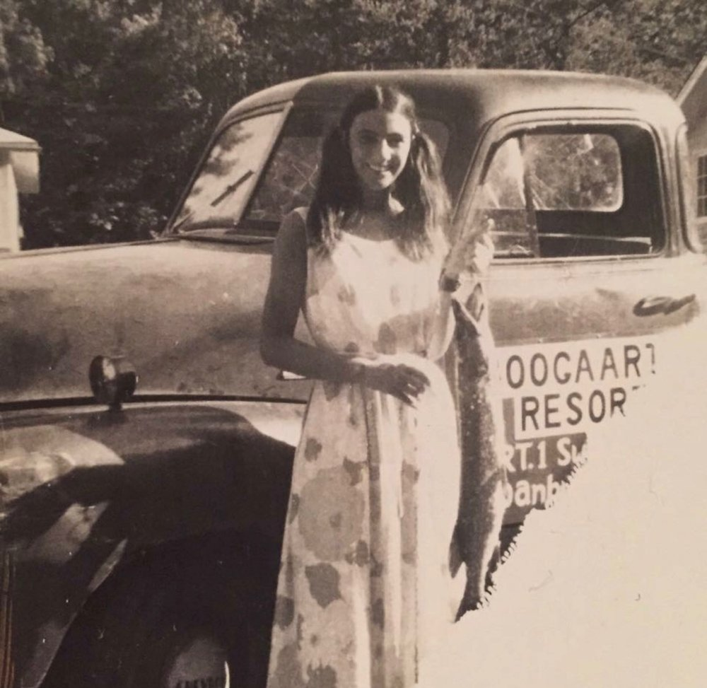 vintage photo of woman with a truck
