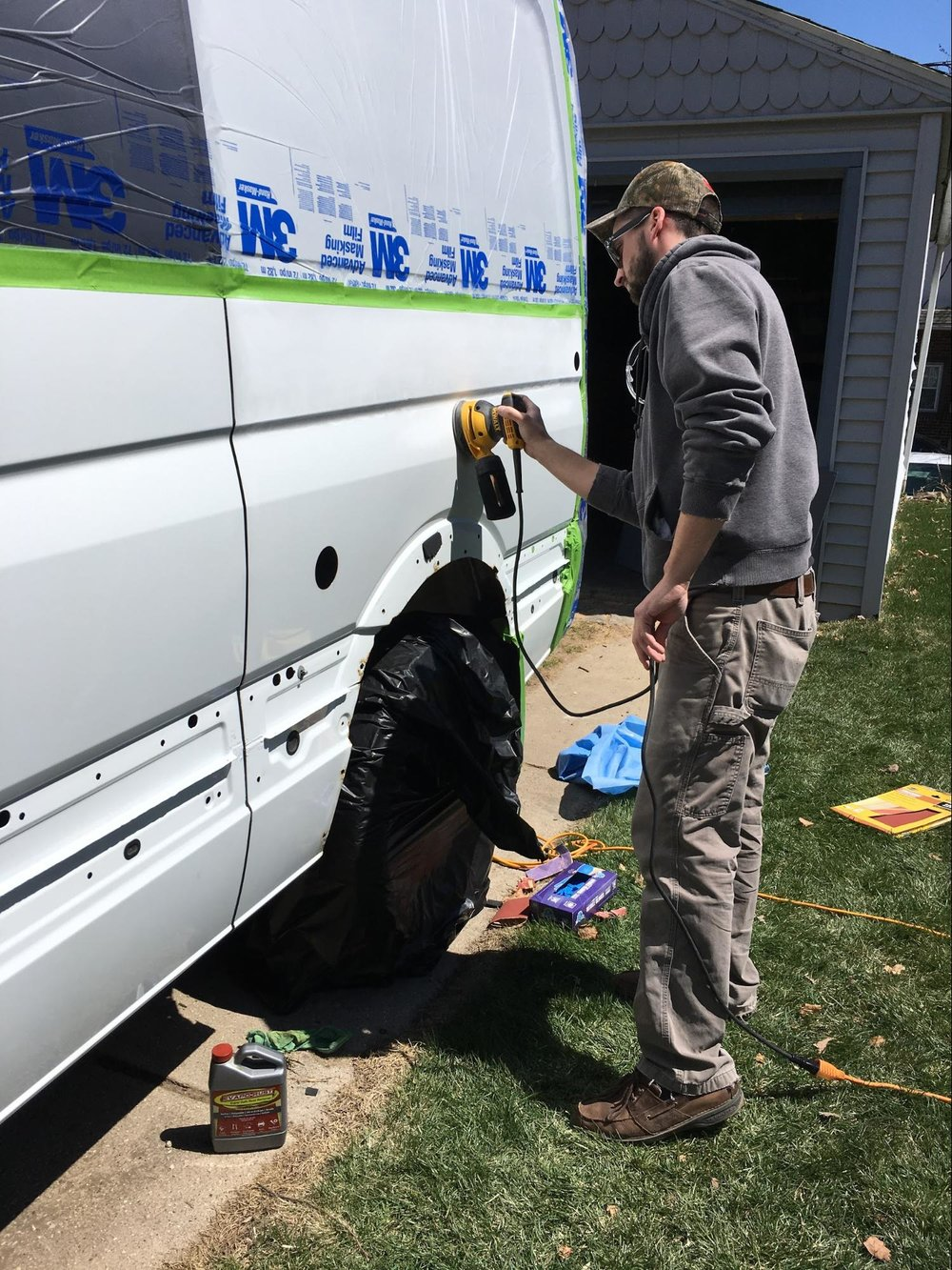 sanding body of sprinter van