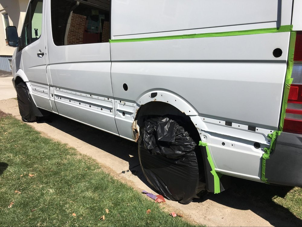 covering wheels with garbage bag while painting sprinter van