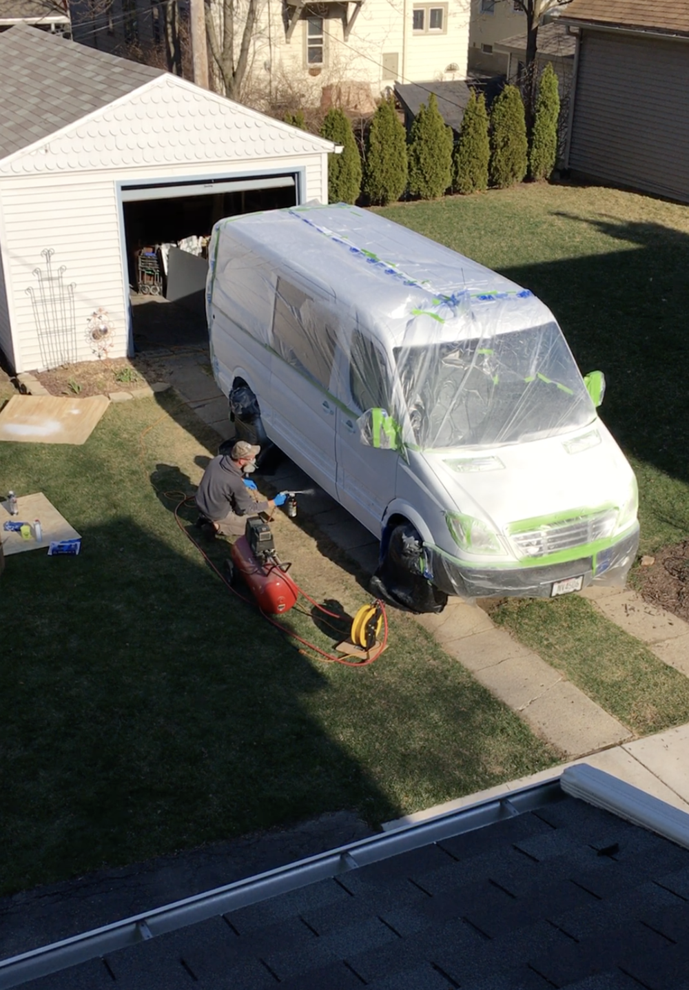 painting exterior of van with tarp
