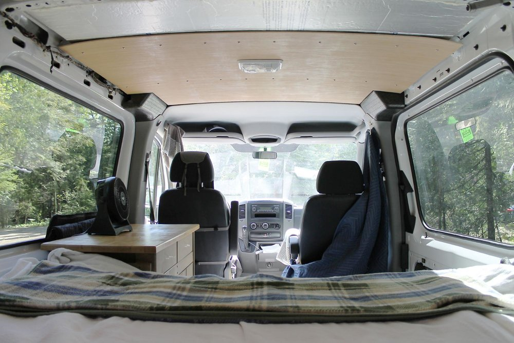 sprinter van interior with bed and decor