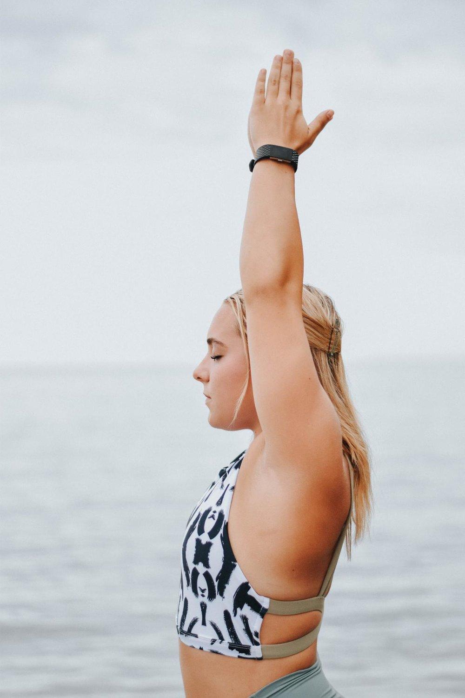 Taryn doing yoga by the lake