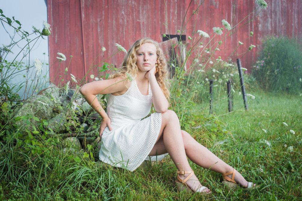 Sparta High School Senior Photos Michigan barn girl sitting white dress