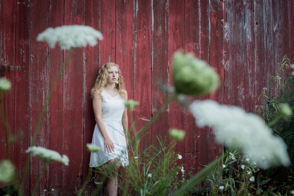 Sparta Michigan red barn Wahlfield park senior photos white dress white flowers