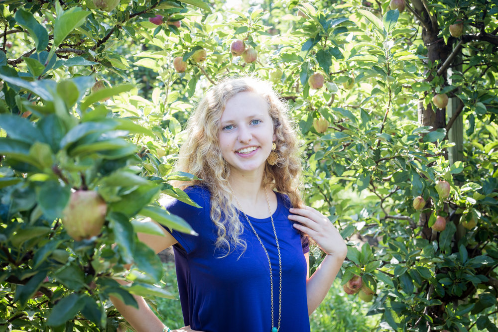 Michigan apple orchard senior blue top blond hair