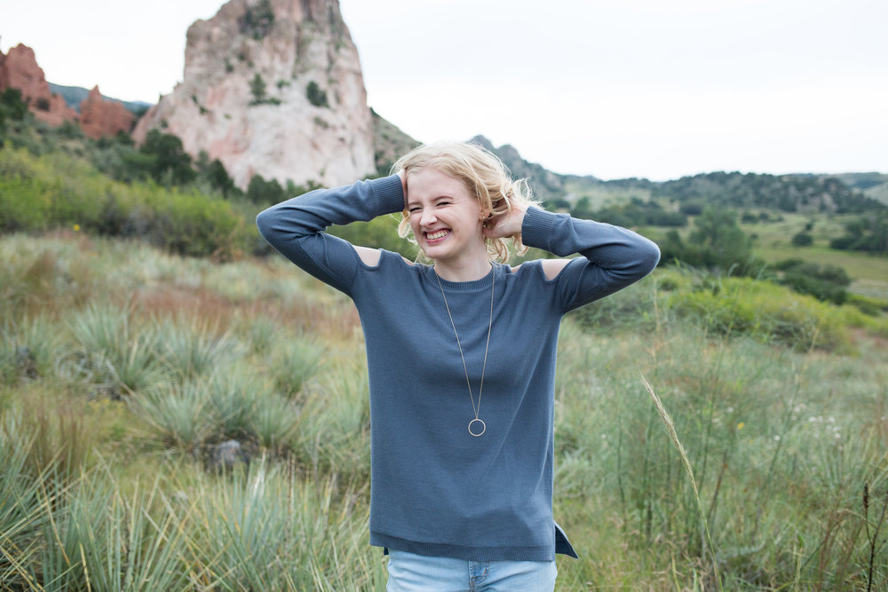 Senior girl standing among the tall grasses in Garden of the Gods with the tall red rocks in the background, Stacy Carosa Photography, Garden of the Gods, Air Academy high School