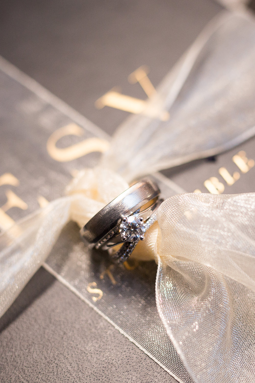Bride and groom wedding rings tied to a Bible Stacy Carosa Photography Winter Wedding in Colorado Springs