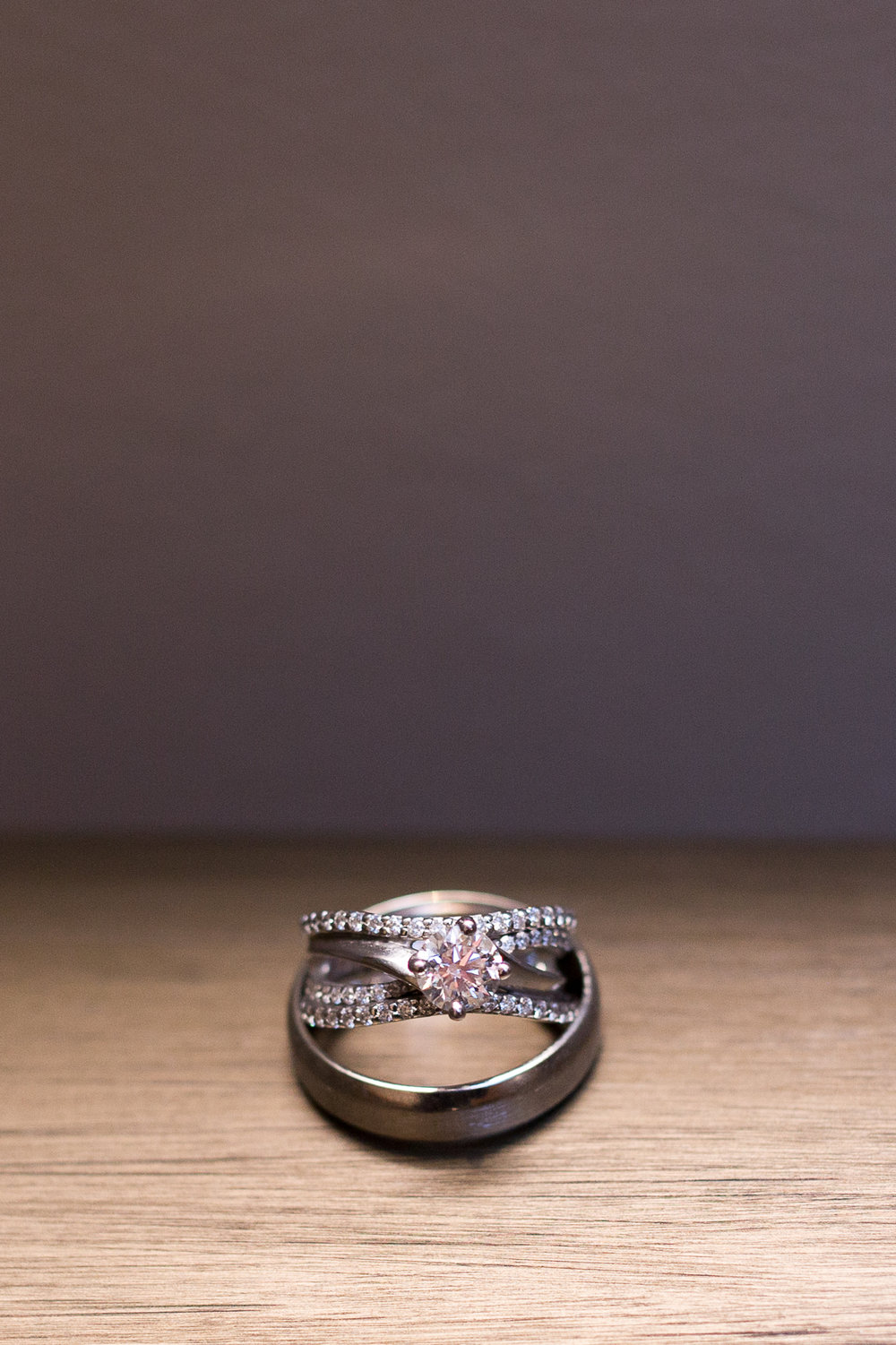 Diamond ring resting in the groom's ring in Colorado  Springs Stacy Carosa Photography