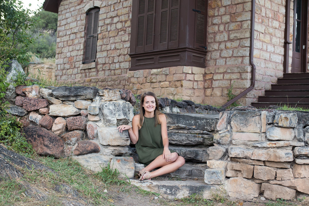 Sitting on stone steps in Rock Ledge Ranch for a senior session | Stacy Carosa Photography | Colorado Springs Senior Photography | Colorado Springs Senior Photography | Denver Senior Photography