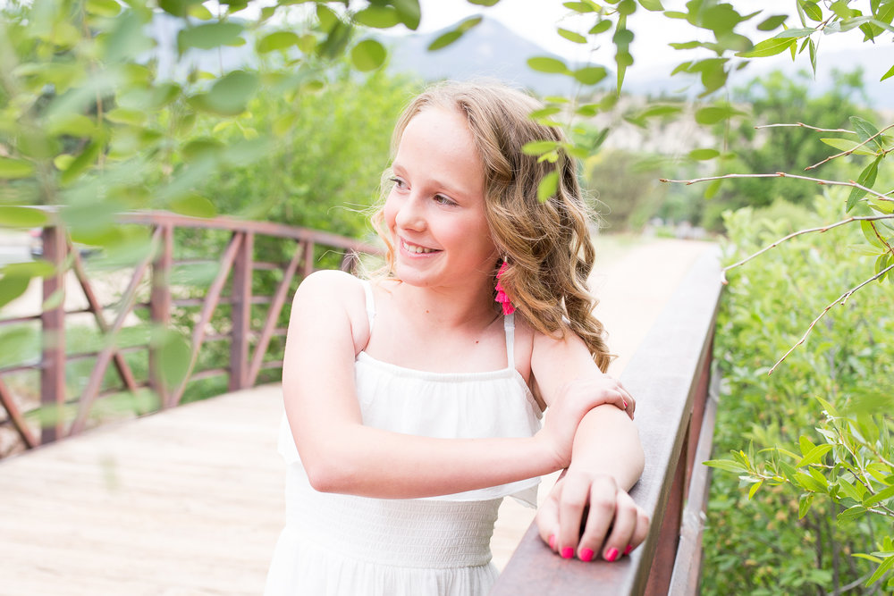 Colorado Springs Senior and Tween Photographer | Colorado  Springs Tween and Senior Photography | Stacy Carosa Photography | girl standing on bridge looking in the distance