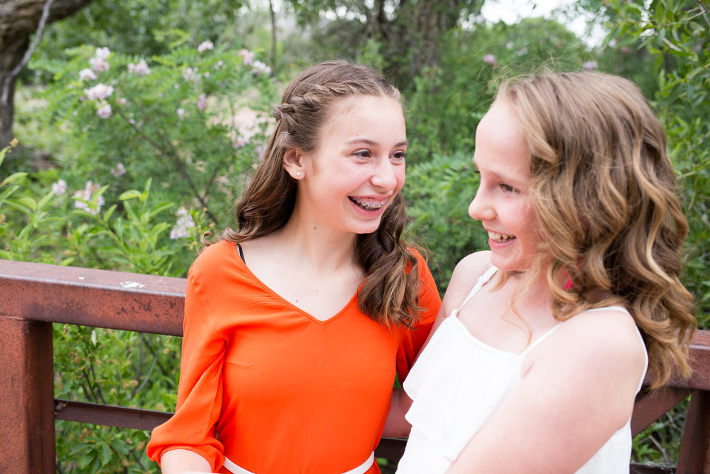 Colorado Springs Tween and senior photographer | Colorado Springs Senior photography | Rock Ledge Ranch | Middle school best friends laughing with each  other on bridge