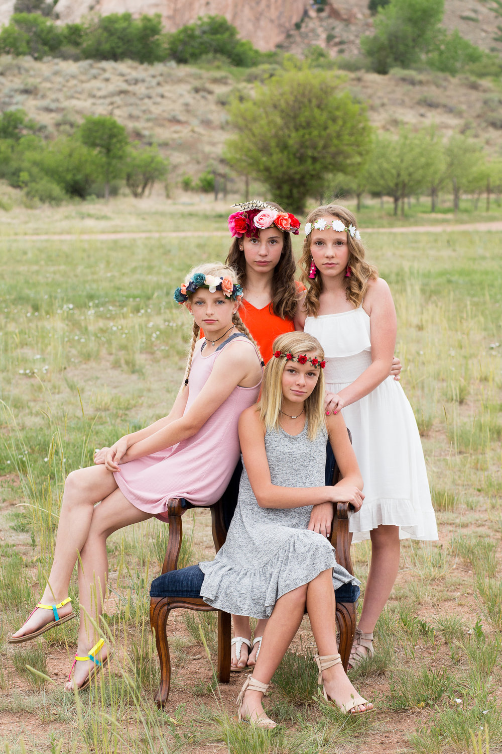 Colorado Springs Senior and Tween Photographer | Colorado  Springs Tween and Senior Photography | Stacy Carosa Photography | Middle School friends session with girls sitting on chair with floral crowns