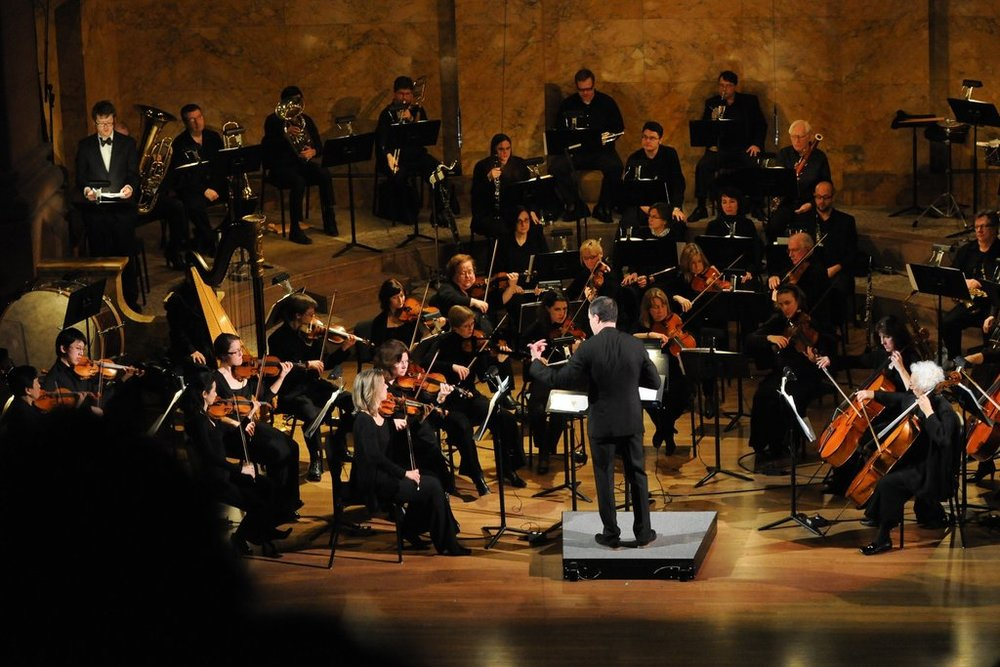 Rossen Milanov conducting the Princeton Symphony Orchestra      Credit: Laura Pedrick for The New York Times