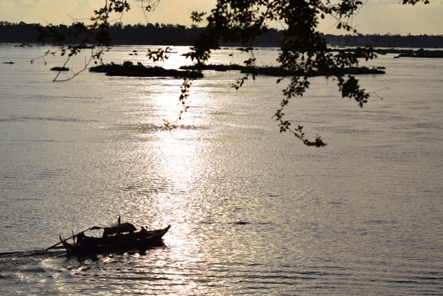The sun begins to set on the Mekong River.