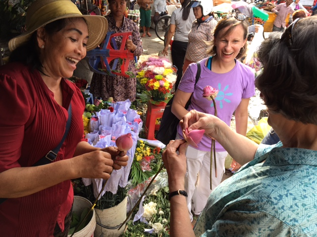 Kay learns the art of folding a Cambodian Lotus Flower, from the market where we buy fresh flowers and produce every weekend.