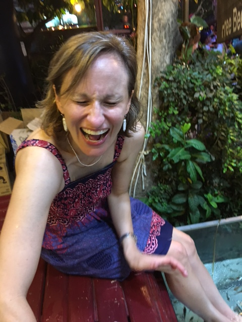 Thais experiences the joy of exfoliation, in a Siem Reap fish tank.