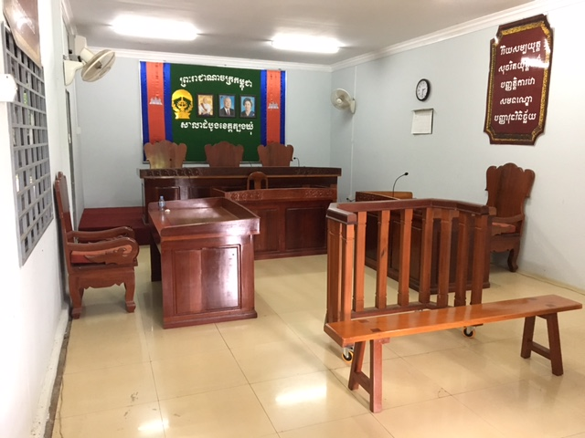 "A typical Cambodian courtroom, with rotating fans to keep everyone ""cool."""