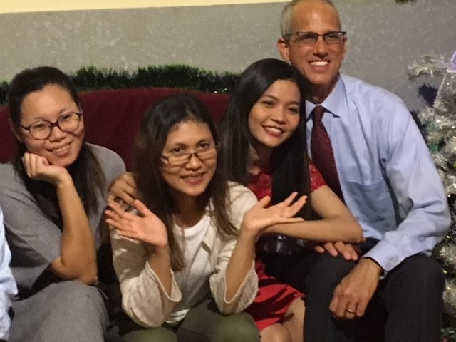 "Me with three of our amazing friends from the IJM-Cambodia Legal Department.  One of them put me in my place after we took this picture, saying, ""Now you have three new daughters!""  (Ouch!)"