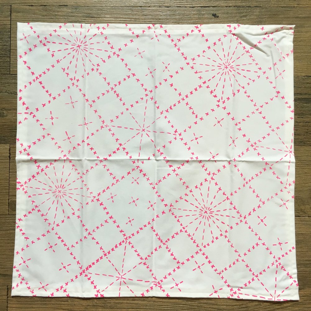 Start with the napkin flat, pattern side facing you.