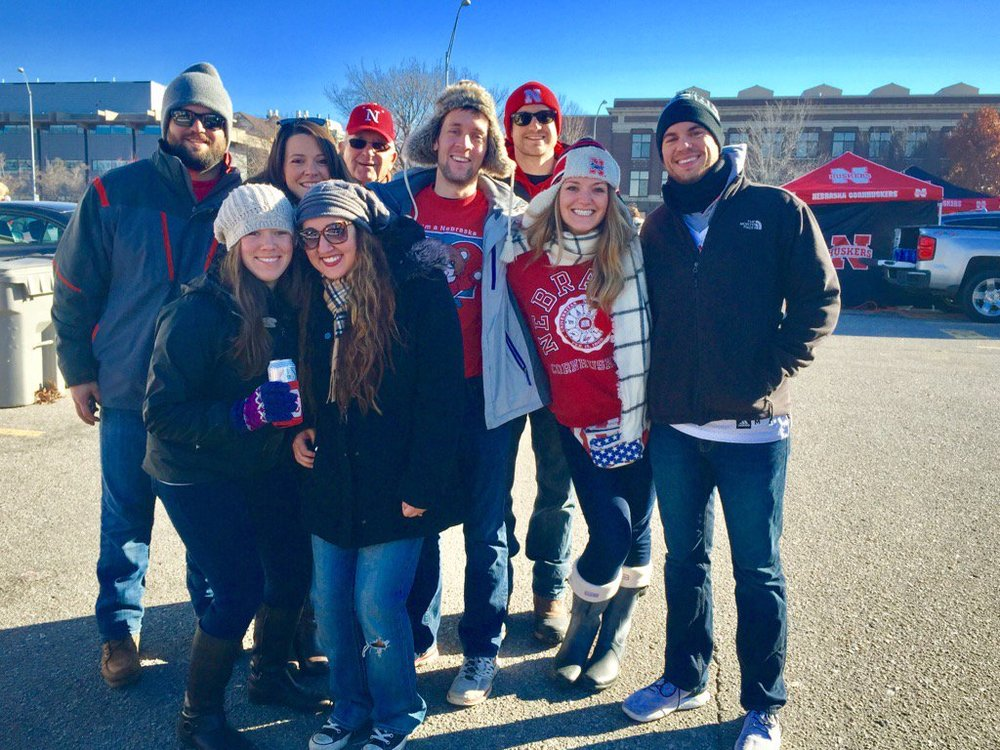 Jordan Schmidt and Sarah Barg (center, both in red sweatshirts) are the hosts of Go Big Tailgate. Give it a listen if you love all things tailgating, football and pop culture!