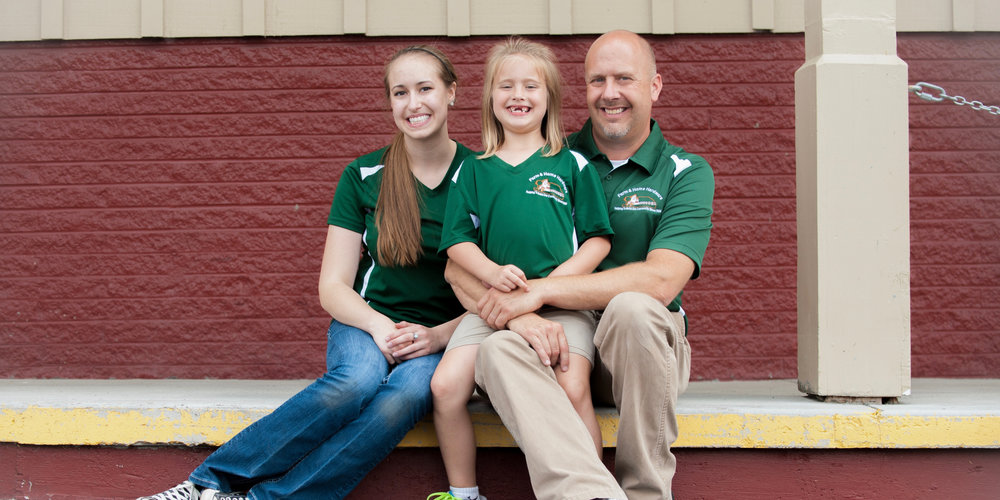 "Scott Jerousek CEO, with two of his daughters Taylor (Left) and ""Mack"" (Center)"