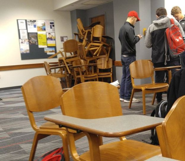 Students barricade a classroom door amid the campus lockdown at Ohio State University