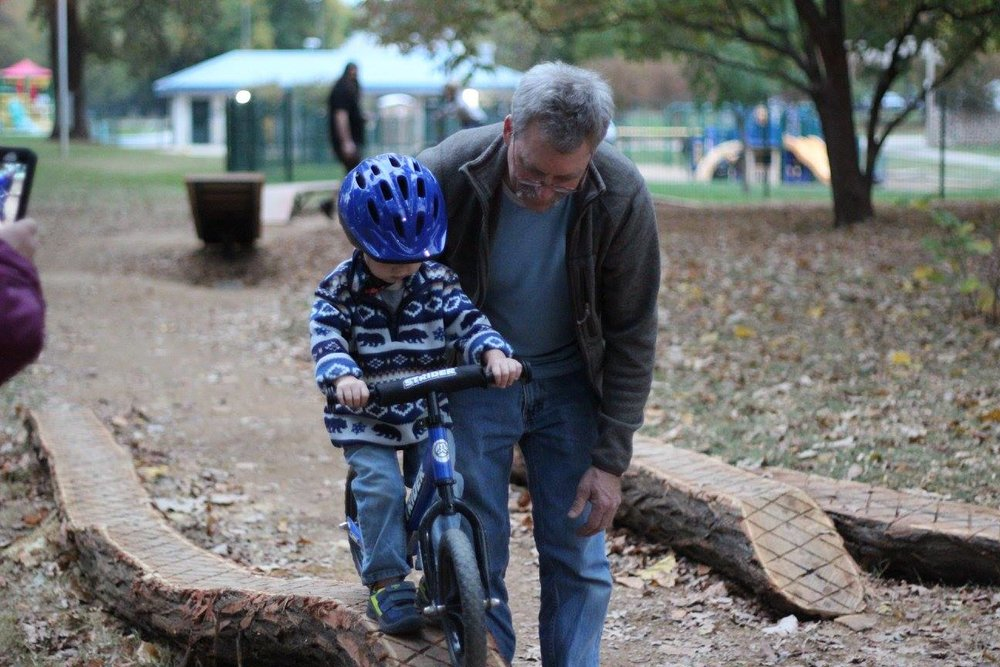 This young man has a pretty strong fear of getting on his bike.  But after seeing all the other kids zooming around, he was determined to ride every obstacle, with the help of his Grandpa of course.