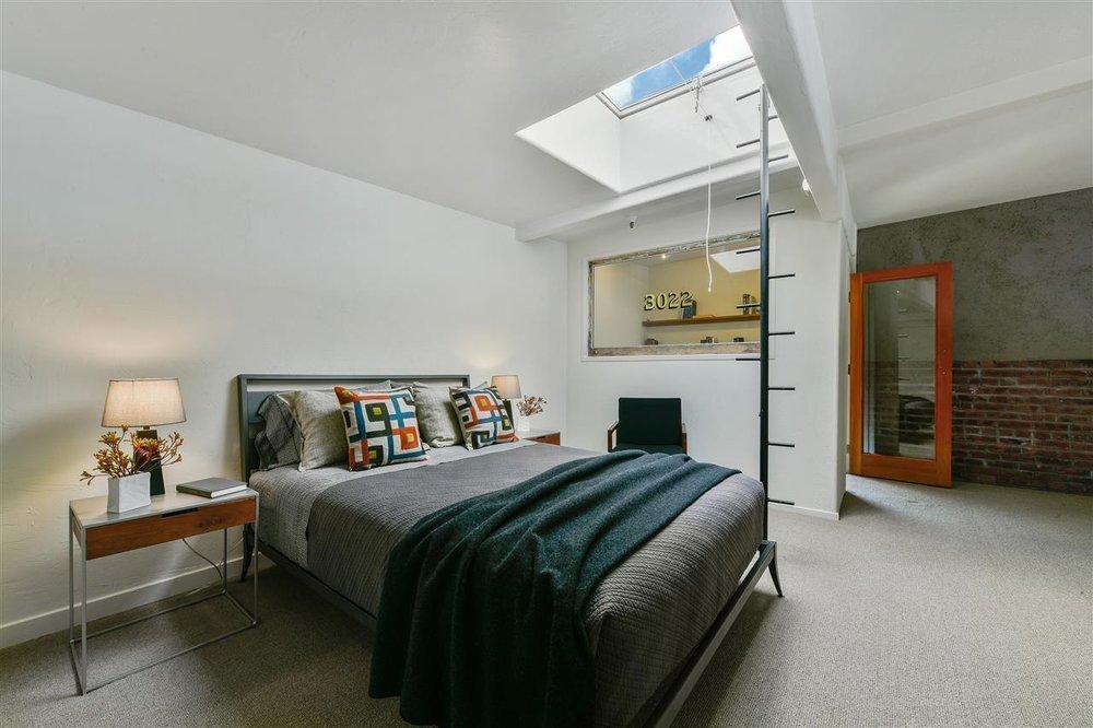 1095 loft bedroom with skylight.jpg
