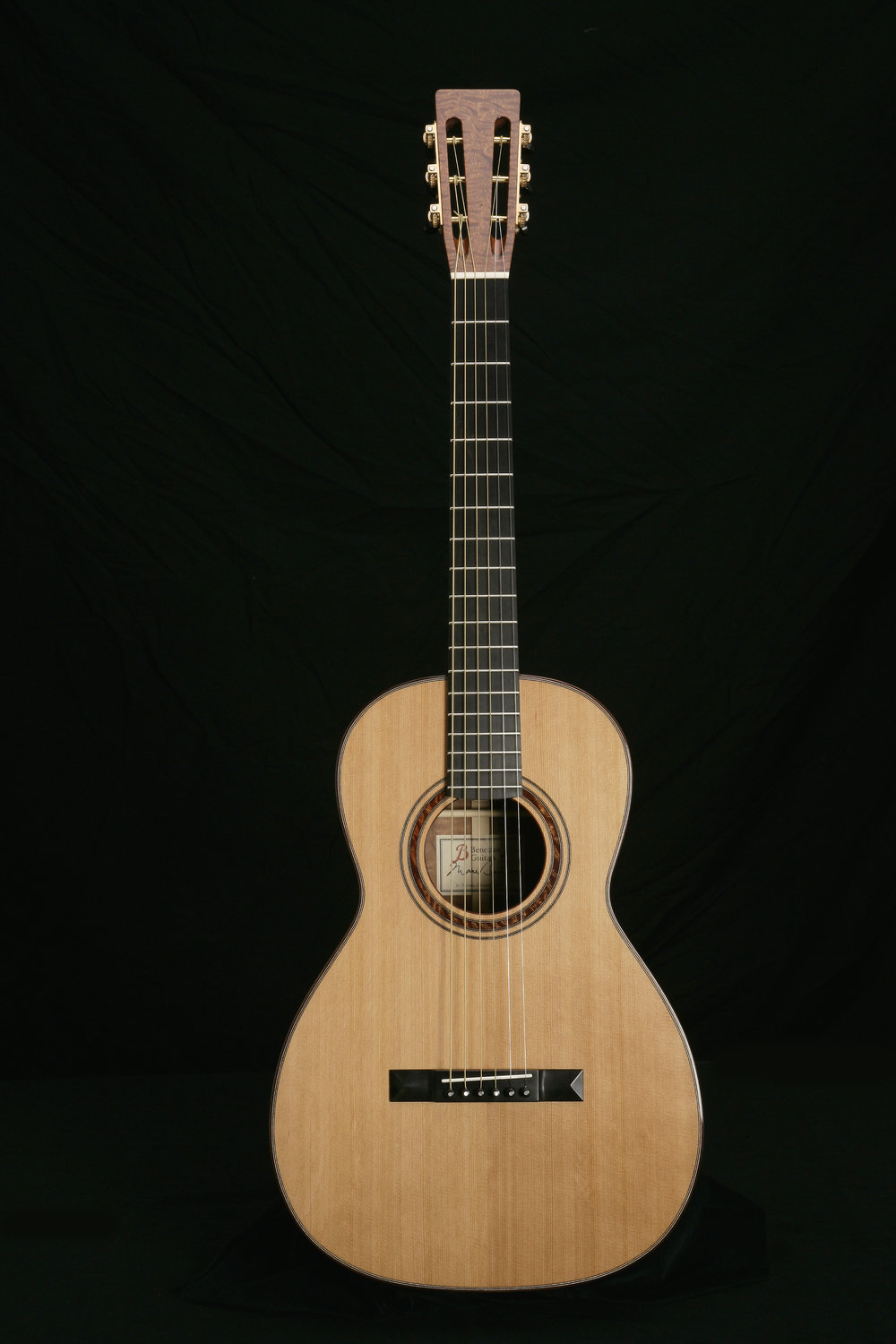 '0' 12 Fret Parlor - This is the quintessential parlor (parlour) guitar and the smallest model that I build. Extremely comfortable to play – the ultimate couch guitar. Well balanced tone from bass to mids to highs, a wonderful fingerstyle instrument. DimensionsUpper Bout: 9 3/8