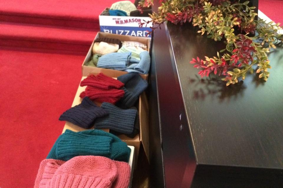 Our Knitters' wares ready to be blessed and sent out into the world