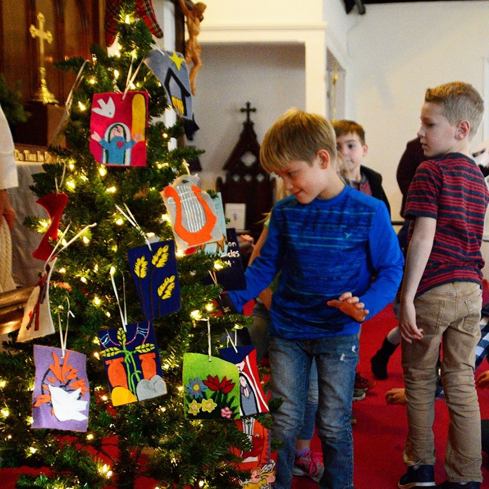 Our Sunday School children decorate the Jesse tree during Mass.