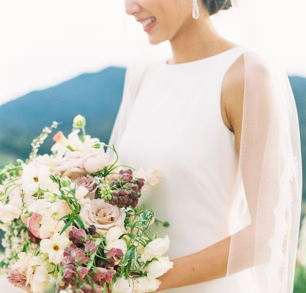 """- FROM BRIDE, HANNAH""""On my wedding day, I was completely blown away by the way our flowers turned out. From my bouquet to the ceremony pieces, everything was far more beautiful than I could have ever imagined.""""READ MORE"""