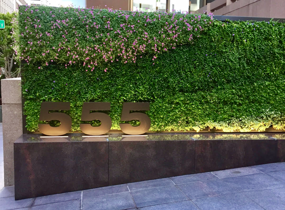 Bringing more nature to the cityscape through green walls is a trend that doesn't seem to be going away anytime soon.We led the effort to add some lively color to the entrance of one of our San Francisco landlord clients.This installation included new stone work, irrigation, signage and lighting.    Architect: Huntsman Architectural Group General Contractor: BCCI Construction