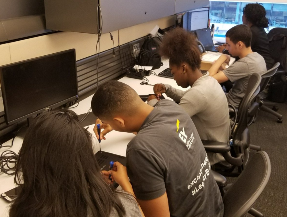 High school interns developing skills in hardware and databases at EY.