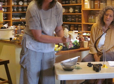 Cheryl demonstrating how to prepare an herbal extraction.