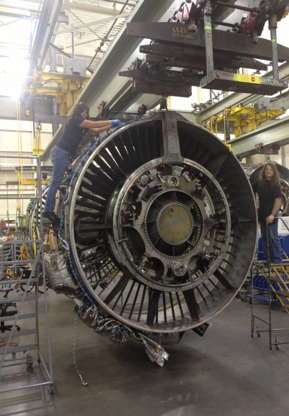 Using tools to take care of an airplane engine