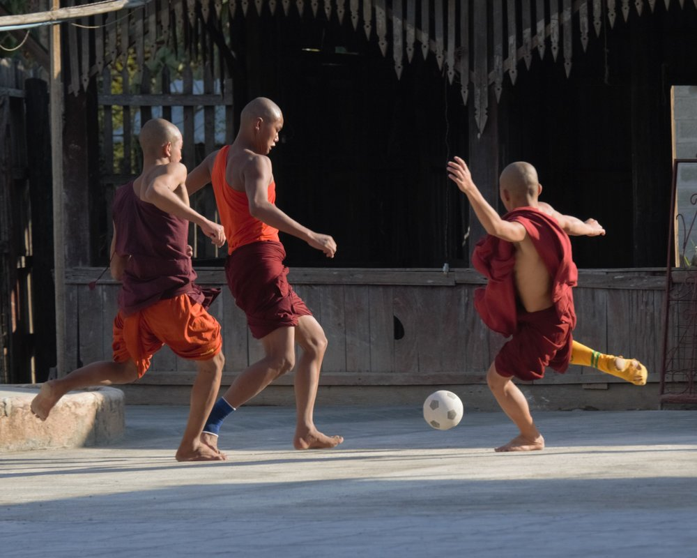 Novice monks playing soccer, Inle Lake