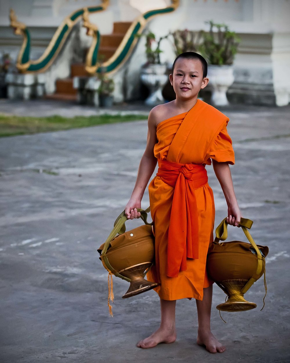 Young novice after Alms round, Luang Prabang