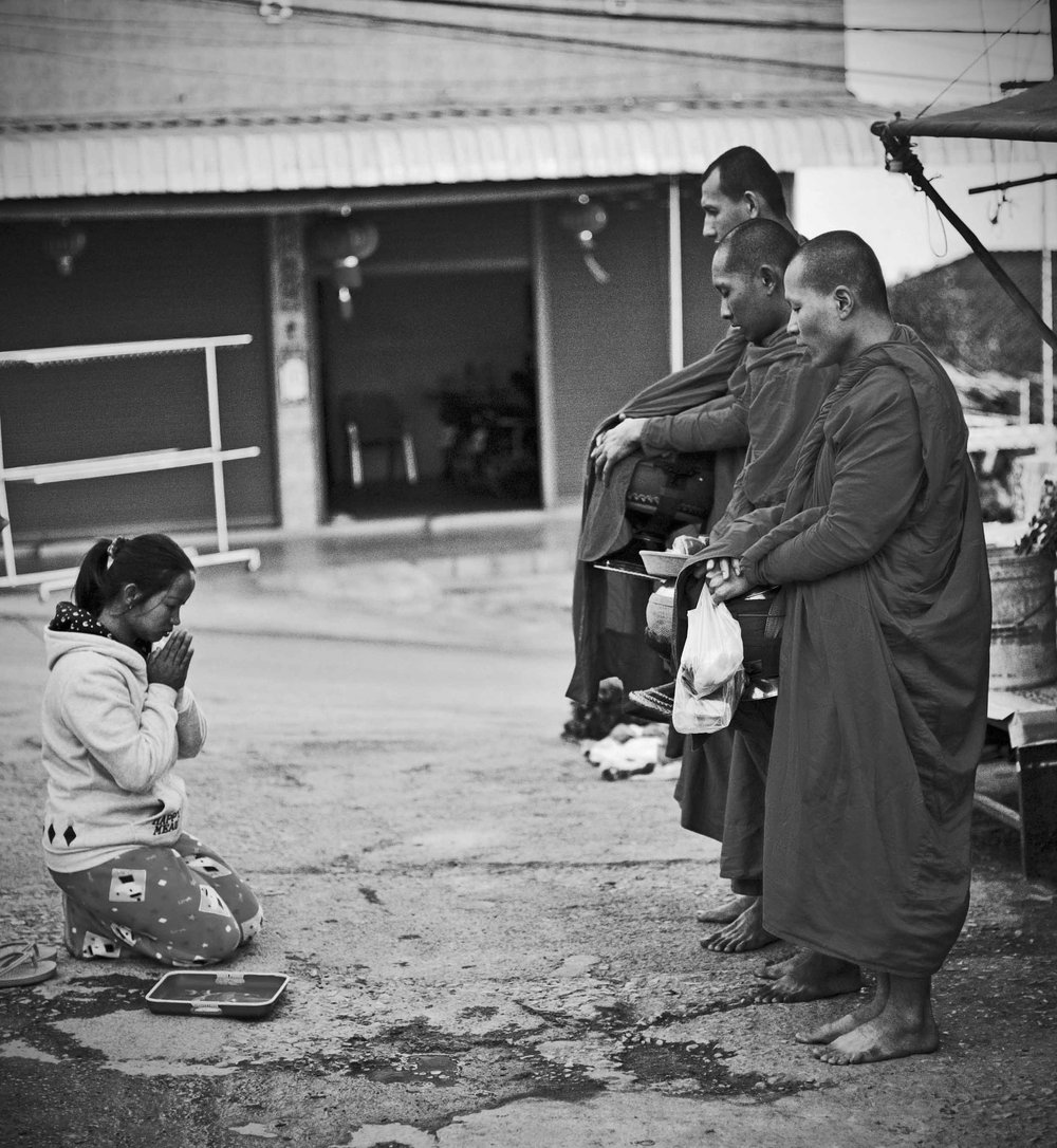 Villager offers food to Monks, Mae Salon, Thailand