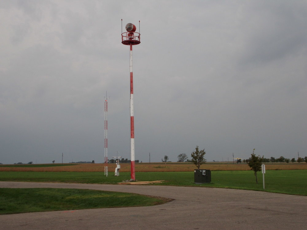 Airfield Beacon and Yellow Mustang Gate Guard