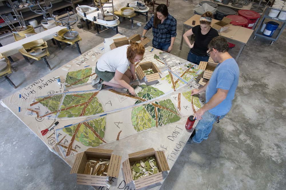 Arial view of students placing tiles.  Photo by Michael Spooneybarger