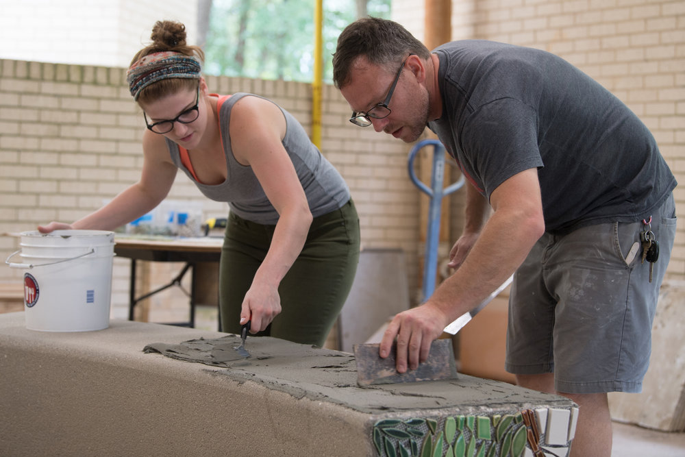 A student and me prepping the top of the bench with mortar. Photo by Michael Spooneybarger