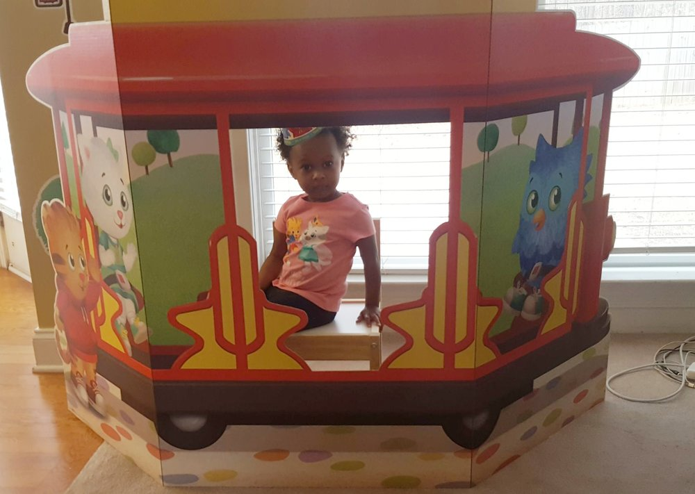 Big sister in cardboard trolley