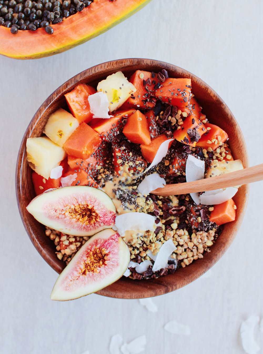 My tropical smoothie bowl topped with buckinis, papaya, cacao nibs & chia seedss