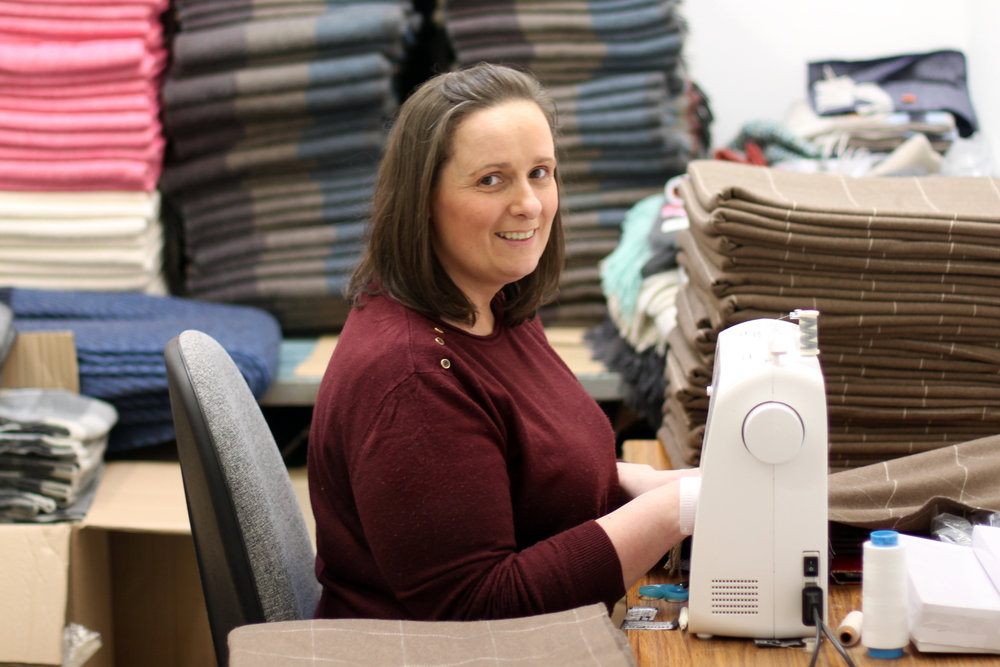 DEMELZA DORAN Quality Assurance & Seamstress Demelza joined McNutt of Donegal in April 2014. She has a keen eye for detail and is in charge of quality control, ensuring all of our scarves and blankets are labeled and in tiptop condition before sending off to our customers. Demelza also controls the regulation of stock, making sure all items are available for our customer orders.