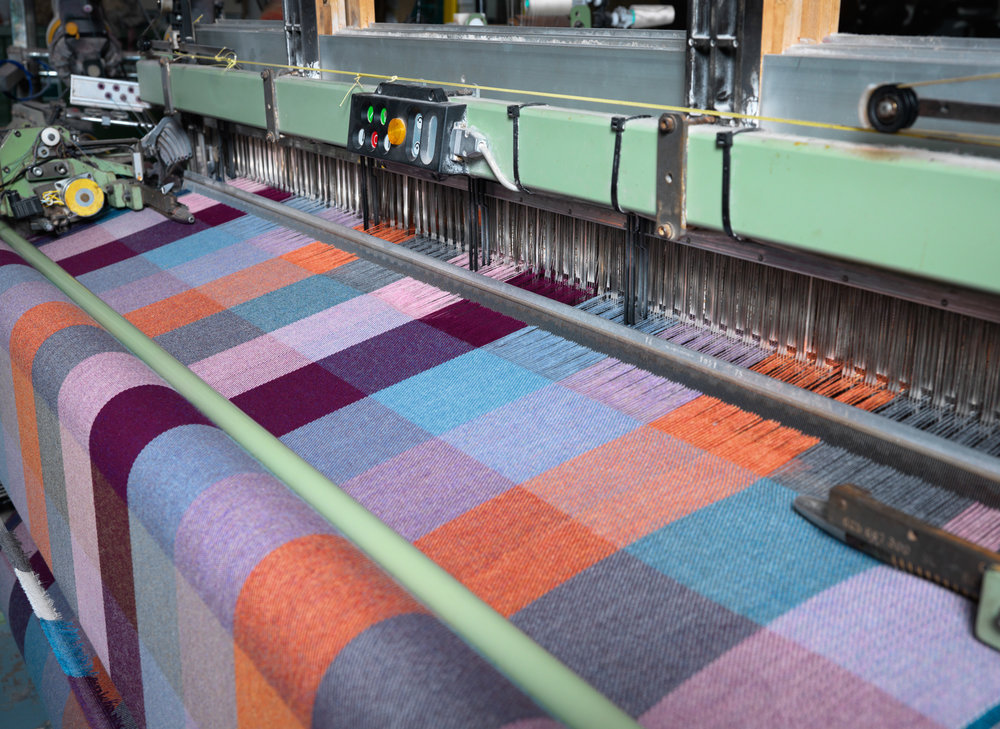 Witness the weaving looms in motion.