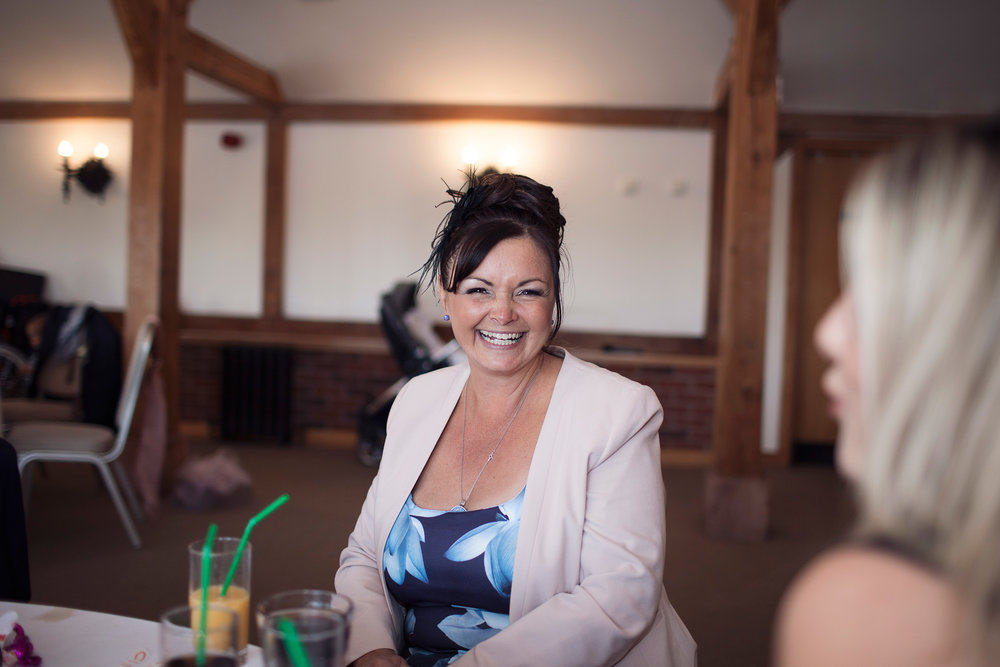 wedding guest smiling having fun at wedding cheshire leeds