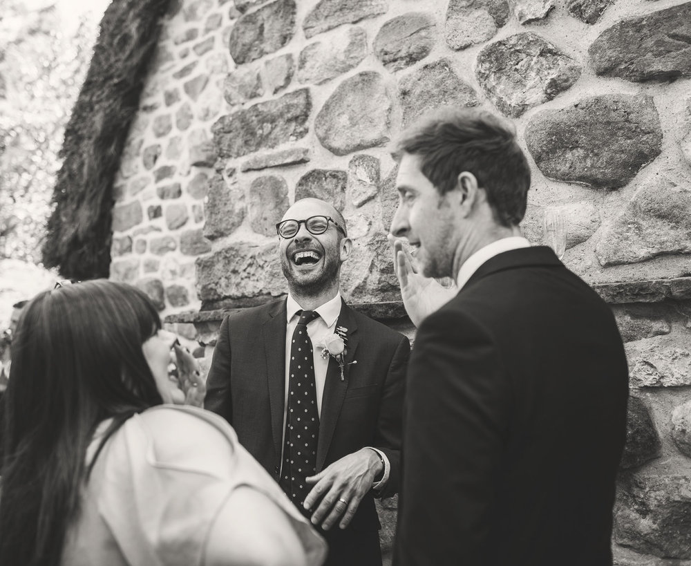 Guests laughing at a wedding in Skipton, Leeds