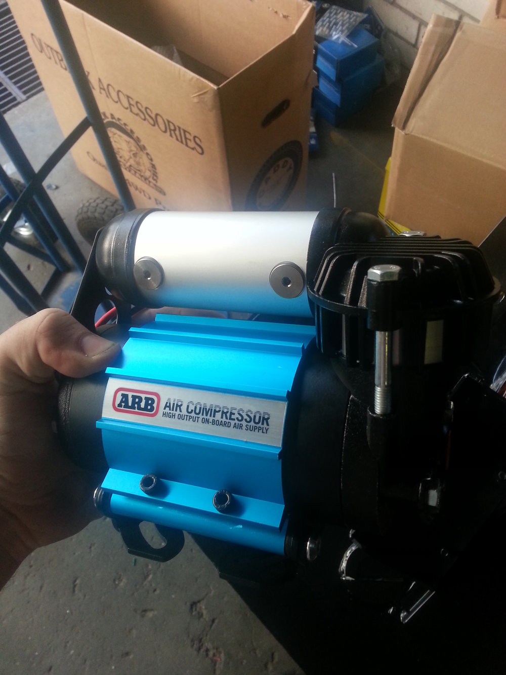 Air Compressor   ARB Compressor into a 2L Airtank and Airlocker kit.   Designed to withstand harsh Australian conditions, each ARB Air Compressor is individually leak tested, current draw tested and flow tested under heavy load at the factory before packing.  For total peace of mind, all ARB compressors come with a comprehensive 2 year warranty. To further increase longevity, ARB compressors are also rebuildable, with spare parts readily available from our extensive network of stores and stockists.